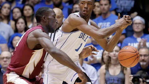 Duke's Harry Giles (1) loses the ball while Florida State's Michael Ojo defends during the first half of an NCAA college basketball game in Durham, N.C., Tuesday, Feb. 28, 2017. (AP Photo/Gerry Broome)