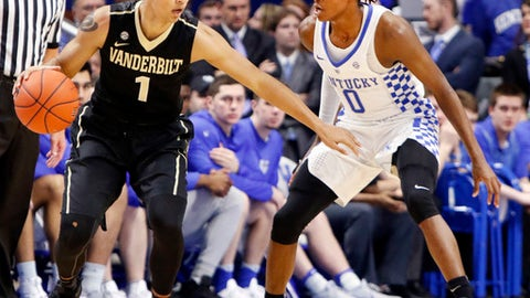 Vanderbilt's Payton Willis (1) looks for an opening on Kentucky's De'Aaron Fox (0) during the first half of an NCAA college basketball game, Tuesday, Feb. 28, 2017, in Lexington, Ky. (AP Photo/James Crisp)