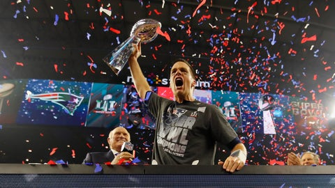 HOUSTON, TX - FEBRUARY 05:  Tom Brady #12 of the New England Patriots raises the Vince Lombardi Trophy after defeating the Atlanta Falcons during Super Bowl 51 at NRG Stadium on February 5, 2017 in Houston, Texas. The Patriots defeated the Falcons 34-28.  (Photo by Kevin C. Cox/Getty Images)