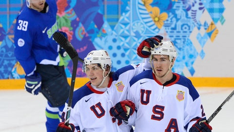 US Ryan Mcdonagh (R) celebrates with his teammate TJ Oshie after scoring a goal during the Men's Ice Hockey Group A match between Slovenia and USA at the Shayba Arena during the Sochi Winter Olympics on February 16, 2014. AFP PHOTO / JONATHAN NACKSTRAND        (Photo credit should read JONATHAN NACKSTRAND/AFP/Getty Images)