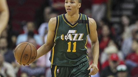 Apr 15, 2015; Houston, TX, USA; Utah Jazz guard Dante Exum (11) brings the ball up the court during the first quarter against the Houston Rockets at Toyota Center. Mandatory Credit: Troy Taormina-USA TODAY Sports