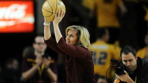 Jan 3, 2016; Tempe, AZ, USA; Arizona State Sun Devils women's basketball coach Charli Turner Thorne is presented with an award marking her 400th career win during the first half of the game against the Arizona Wildcats at Wells-Fargo Arena. The Wildcats won 94-82. Mandatory Credit: Joe Camporeale-USA TODAY Sports