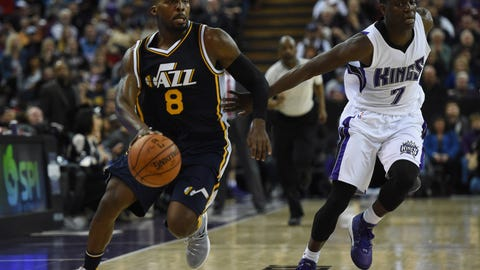 Mar 13, 2016; Sacramento, CA, USA; Utah Jazz guard Shelvin Mack (8) is defended by Sacramento Kings guard Darren Collison (7) during an NBA game at Sleep Train Arena. The Jazz defeated the Kings 108-99. Mandatory Credit: Kirby Lee-USA TODAY Sports