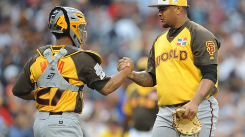 Jul 10, 2016; San Diego, CA, USA; World pitcher Adalberto Mejia (right) celebrates with catcher Francisco Mejia (left) after defeating USA during the All Star Game futures baseball game at PetCo Park. Mandatory Credit: Gary A. Vasquez-USA TODAY Sports