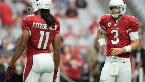 Sep 18, 2016; Glendale, AZ, USA; Arizona Cardinals wide receiver Larry Fitzgerald (11) and Arizona Cardinals quarterback Carson Palmer (3) warm up prior to facing the Tampa Bay Buccaneers at University of Phoenix Stadium. The Cardinals won 40-7. Mandatory Credit: Joe Camporeale-USA TODAY Sports
