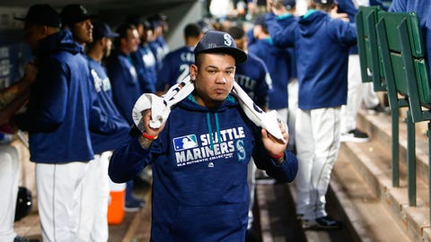 Sep 29, 2016; Seattle, WA, USA; Seattle Mariners starting pitcher Felix Hernandez (34) walks in the dugout before the first inning against the Oakland Athletics at Safeco Field. Seattle defeated Oakland, 3-2. Mandatory Credit: Joe Nicholson-USA TODAY Sports