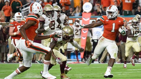 Oct 8, 2016; Miami Gardens, FL, USA; Miami Hurricanes running back Mark Walton (1) carries the ball past Florida State Seminoles during the first half at Hard Rock Stadium. Mandatory Credit: Steve Mitchell-USA TODAY Sports