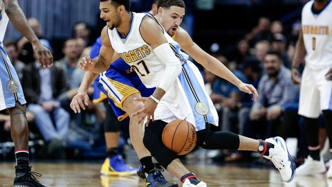 Nov 10, 2016; Denver, CO, USA; Denver Nuggets guard Jamal Murray (27) loses control of the ball against Golden State Warriors guard Klay Thompson (11) in the third quarter at the Pepsi Center. The Warriors defeated the Nuggets 125-101. Mandatory Credit: Isaiah J. Downing-USA TODAY Sports