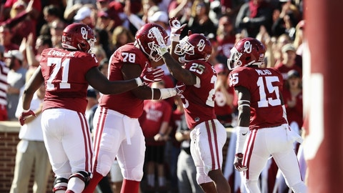 Nov 12, 2016; Norman, OK, USA; Oklahoma Sooners running back Joe Mixon (25) celebrates with teammates after scoring a touchdown during the second half against the Baylor Bears at Gaylord Family - Oklahoma Memorial Stadium. Mandatory Credit: Kevin Jairaj-USA TODAY Sports