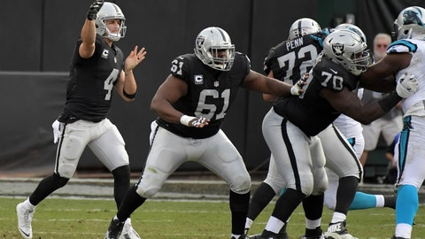 Nov 27, 2016; Oakland, CA, USA; Oakland Raiders quarterback Derek Carr (4) throws as center Rodney Hudson (61) and offensive guard Kelechi Osemele (70) block against the Carolina Panthers during the second half at Oakland-Alameda County Coliseum. Mandatory Credit: Kirby Lee-USA TODAY Sports