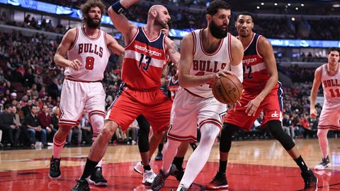 Dec 21, 2016; Chicago, IL, USA;  Chicago Bulls forward Nikola Mirotic (44) grabs an offensive rebound against Washington Wizards center Marcin Gortat (13) during the first half at the United Center. Mandatory Credit: Mike DiNovo-USA TODAY Sports