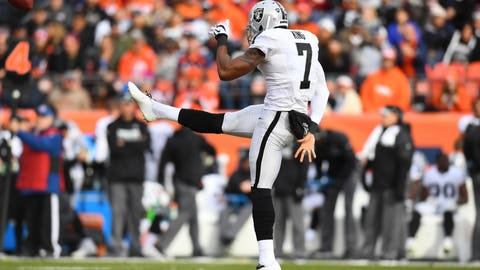 Jan 1, 2017; Denver, CO, USA; Oakland Raiders punter Marquette King (7) kicks the ball away in the first half against the Denver Broncos at Sports Authority Field. Mandatory Credit: Ron Chenoy-USA TODAY Sports