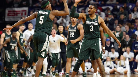 Jan 7, 2017; Philadelphia, PA, USA; Michigan State Spartans guard Cassius Winston (5) high-fives guard Alvin Ellis III (3) during the second half against the Penn State Nittany Lions at Palestra. Mandatory Credit: Derik Hamilton-USA TODAY Sports