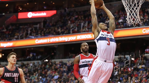 Jan 16, 2017; Washington, DC, USA; Washington Wizards guard Bradley Beal (3) dunks the ball as Wizards guard John Wall (2) and Portland Trail Blazers forward Meyers Leonard (11) look on in the fourth quarter at Verizon Center. The Wizards won 120-101. Mandatory Credit: Geoff Burke-USA TODAY Sports