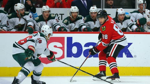 Jan 15, 2017; Chicago, IL, USA; Chicago Blackhawks right wing Patrick Kane (88) being defended by Minnesota Wild defenseman Jared Spurgeon (46) during the first period at the United Center. Mandatory Credit: Dennis Wierzbicki-USA TODAY Sports