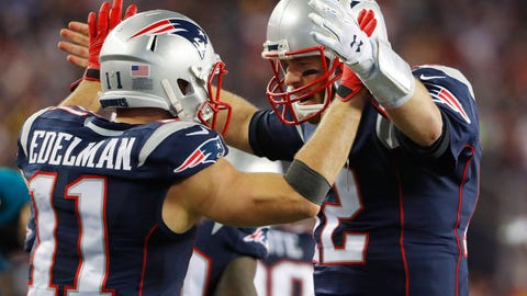 Jan 22, 2017; Foxborough, MA, USA; New England Patriots quarterback Tom Brady (12) celebrates a touchdown with wide receiver Julian Edelman (11) during the 2017 AFC Championship Game against the Pittsburgh Steelers at Gillette Stadium. Mandatory Credit: Winslow Townson-USA TODAY Sports