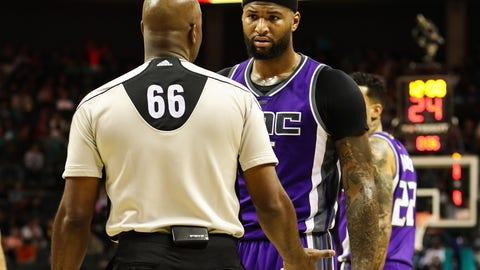 Jan 28, 2017; Charlotte, NC, USA; Sacramento Kings forward DeMarcus Cousins (15) talks over a call with referee Haywoode Workman (66) during the first half at the Spectrum Center. Mandatory Credit: Jim Dedmon-USA TODAY Sports