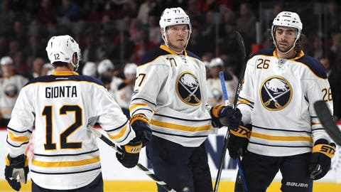 Jan 31, 2017; Montreal, Quebec, CAN; Buffalo Sabres defenseman Dmitry Kulikov (77) celebrates his goal against Montreal Canadiens with right wing Brian Gionta (12) and left wing Matt Moulson (26) during the third period at Bell Centre. Mandatory Credit: Jean-Yves Ahern-USA TODAY Sports