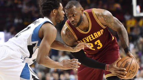 Feb 1, 2017; Cleveland, OH, USA; Cleveland Cavaliers forward LeBron James (23) works against Minnesota Timberwolves forward Andrew Wiggins (22) during the second half at Quicken Loans Arena. The Cavs won 125-97. Mandatory Credit: Ken Blaze-USA TODAY Sports