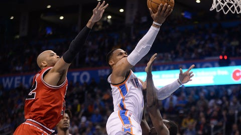 Feb 1, 2017; Oklahoma City, OK, USA; Oklahoma City Thunder guard Russell Westbrook (0) drives to the basket between Chicago Bulls forward Taj Gibson (22) and guard Jerian Grant (2) during the second quarter at Chesapeake Energy Arena. Mandatory Credit: Mark D. Smith-USA TODAY Sports