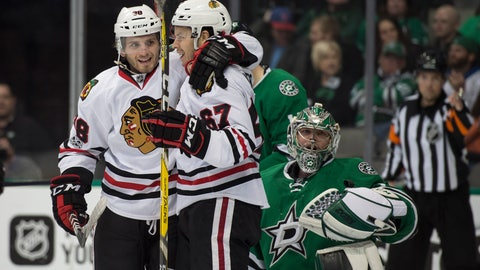 Feb 4, 2017; Dallas, TX, USA; Chicago Blackhawks right wing Ryan Hartman (38) and center Tanner Kero (67) celebrate a goal against Dallas Stars goalie Kari Lehtonen (32) during the second period at the American Airlines Center. Mandatory Credit: Jerome Miron-USA TODAY Sports