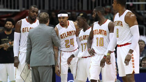Feb 8, 2017; Atlanta, GA, USA; Atlanta Hawks head coach Mike Budenholzer talks with forward Paul Millsap (4) and forward Kent Bazemore (24) and guard Dennis Schroder (17) and guard Tim Hardaway Jr. (10) and center Dwight Howard (8) during a time out in the fourth quarter of their game game against the Denver Nuggets at Philips Arena. The Hawks won 117-106. Mandatory Credit: Jason Getz-USA TODAY Sports