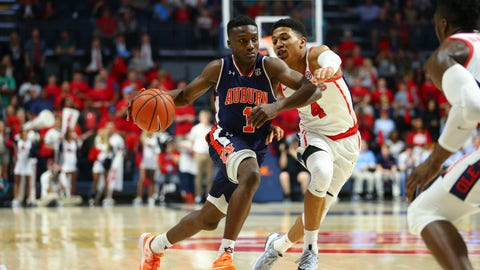 Feb 11, 2017; Oxford, MS, USA; Auburn Tigers guard Jared Harper (1) drives to the basket against Mississippi Rebels guard Breein Tyree (4) during the second half at The Pavilion at Ole Miss. Mississippi defeated Auburn 90-84.  Mandatory Credit: Spruce Derden-USA TODAY Sports