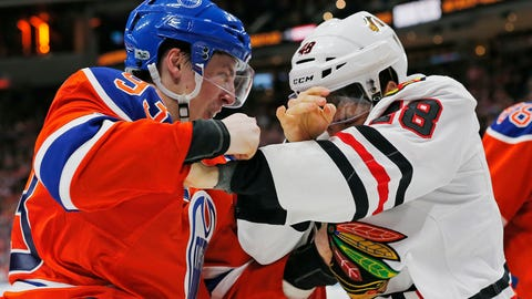 Feb 11, 2017; Edmonton, Alberta, CAN; Edmonton Oilers forward Ryan Nugent-Hopkins (93) and Chicago Blackhawks forward Vinnie Hinostroza (48) fight during the third period at Rogers Place. Mandatory Credit: Perry Nelson-USA TODAY Sports