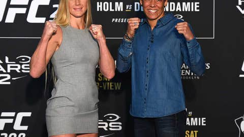 BROOKLYN, NY - FEBRUARY 08: (L-R) Holly Holm and Germaine de Randamie of The Netherlands face off during the UFC 208 Ultimate Media Day at the Barclays Center on February 8, 2017 in Brooklyn, New York. (Photo by Jeff Bottari/Zuffa LLC/Zuffa LLC via Getty Images)