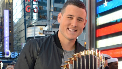 GOOD MORNING AMERICA - Veteran's Day is celebrated on GOOD MORNING AMERICA, 11/11/16, airing on the ABC Television Network.   (Photo by Ida Mae Astute/ABC via Getty Images)  ANTHONY RIZZO of the Chicago Cubs brings the WORLD SERIES TROPHY to Times Square
