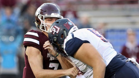 Samford defensive lineman Jared Holloway (91) hits Mississippi State quarterback Nick Fitzgerald (7) during the second half of an NCAA college football game in Starkville, Miss., Saturday, Oct. 29, 2016. Holloway's hit was ruled targeting and he was ejected from the game. (AP Photo/Jim Lytle)