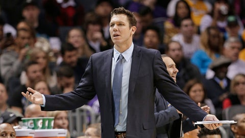 Los Angeles Lakers coach Luke Walton reacts to a call during the second half of the team's NBA basketball game against the Charlotte Hornets in Charlotte, N.C., Tuesday, Dec. 20, 2016. The Hornets won 117-113. (AP Photo/Chuck Burton)