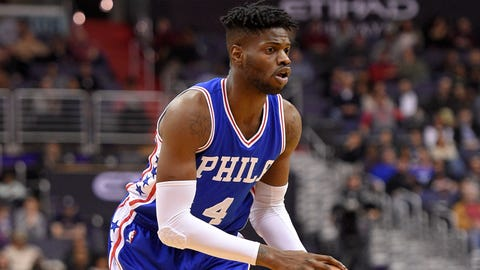 Philadelphia 76ers forward/center Nerlens Noel handles the ball during the first half of an NBA basketball game against the Washington Wizards, Saturday, Jan. 14, 2017, in Washington. (AP Photo/Nick Wass)