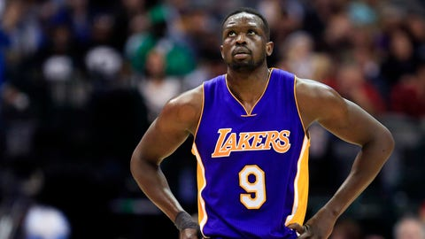 Los Angeles Lakers forward Luol Deng (9) walks toward the bench during the second half of an NBA basketball game against the Dallas Mavericks, Sunday, Jan. 22, 2017, in Dallas. (AP Photo/Ron Jenkins)