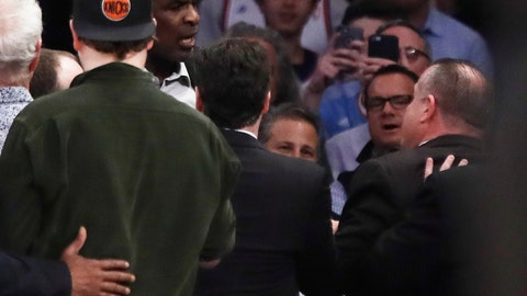Former New York Knicks player Charles Oakley exchanges words with a security guard during the first half of an NBA basketball game between the New York Knicks and the LA Clippers, Wednesday, Feb. 8, 2017, in New York. (AP Photo/Frank Franklin II)