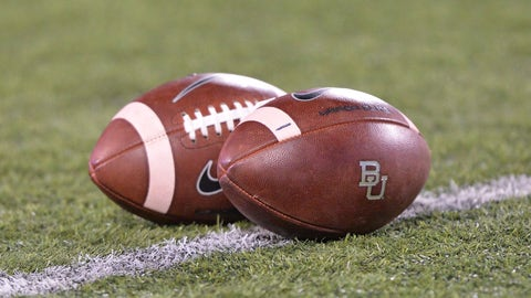 MANHATTAN, KS - NOVEMBER 05:  A general view of footballs on the field prior to a game between the Baylor Bears and the Kansas State Wildcats on November 5, 2015 at Bill Snyder Family Stadium in Manhattan, Kansas.  (Photo by Peter G. Aiken/Getty Images) *** Local Caption ***