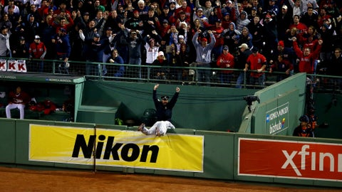 BOSTON, MA - OCTOBER 13:  Torii Hunter #48 of the Detroit Tigers falls over the bullpen fence after trying to catch a grand slam hit by David Ortiz #34 of the Boston Red Sox as Boston Police Officer Steve Horgan celebrates in the eighth inning as Boston police officer Steve Horgan cheers in Game Two of the American League Championship Series at Fenway Park on October 13, 2013 in Boston, Massachusetts.  (Photo by Al Bello/Getty Images)