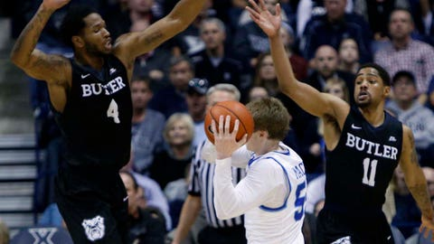 Feb 26, 2017; Cincinnati, OH, USA; Xavier Musketeers guard J.P. Macura (55) is double covered during the second half by the Butler Bulldogs forward Tyler Wideman (4) and guard Kethan Savage (11) at the Cintas Center. Butler won 88-79. Mandatory Credit: Frank Victores-USA TODAY Sports