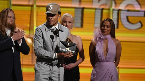 Chance The Rapper receives the Grammy for Best new Artist as Jennifer Lopez (R) looks on during the 59th Annual Grammy music Awards on February 12, 2017, in Los Angeles, California.  / AFP / VALERIE MACON        (Photo credit should read VALERIE MACON/AFP/Getty Images)