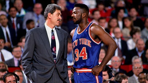 CHICAGO -1991: Charles Oakley #34 of the New York Knicks stares down Phil Jackson, head coach of the Chicago Bulls during an NBA game at Chicago Stadium in Chicago, Illinois in 1991.  NOTE TO USER: User expressly acknowledges that, by downloading and or using this photograph, User is consenting to the terms and conditions of the Getty Images License agreement. Mandatory Copyright Notice: Copyright 2006 NBAE (Photo by Nathaniel S. Butler/NBAE via Getty Images)