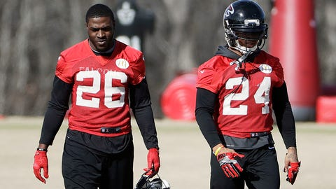 Atlanta Falcons running backs Tevin Coleman, left, and Devonta Freeman walk on the field during a workout at the football team's practice facility in Flowery Branch, Ga., Wednesday, Jan. 25, 2017. (AP Photo/David Goldman)