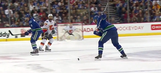 Watch Canucks defenseman score on a knuckle puck from center ice