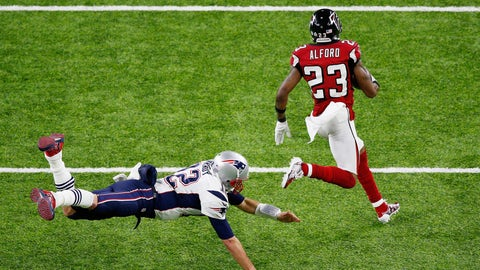 HOUSTON, TX - FEBRUARY 05:  Robert Alford #23 of the Atlanta Falcons runs past Tom Brady #12 of the New England Patriots on his way to scoring a touchdown on an 82-yard interception return against the New England Patriots in the second quarter of Super Bowl 51 at NRG Stadium on February 5, 2017 in Houston, Texas.  (Photo by Bob Levey/Getty Images)