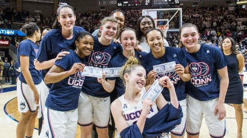 STORRS, CT - FEBRUARY 13: UConn Huskies celebrate after UConn Huskies Head Coach Geno Auriemma reaches the 100 consecutive win mark after defeating 6th ranked University of South Carolina by a score of 66-55 on February 13, 2017, at the Harry A. Gampel Pavilion in Storrs, CT. (Photo by David Hahn/Icon Sportswire via Getty Images)