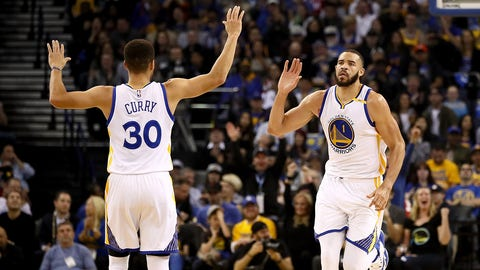OAKLAND, CA - DECEMBER 15:  JaVale McGee #1 of the Golden State Warriors is congratulated by Stephen Curry #30 after he dunked the ball against the New York Knicks at ORACLE Arena on December 15, 2016 in Oakland, California. NOTE TO USER: User expressly acknowledges and agrees that, by downloading and or using this photograph, User is consenting to the terms and conditions of the Getty Images License Agreement.  (Photo by Ezra Shaw/Getty Images)