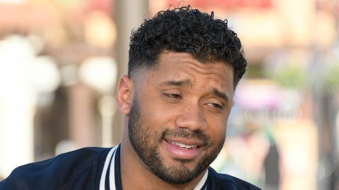 """UNIVERSAL CITY, CA - JANUARY 31:  Russell Wilson visits """"Extra"""" at Universal Studios Hollywood on January 31, 2017 in Universal City, California.  (Photo by Noel Vasquez/Getty Images)"""