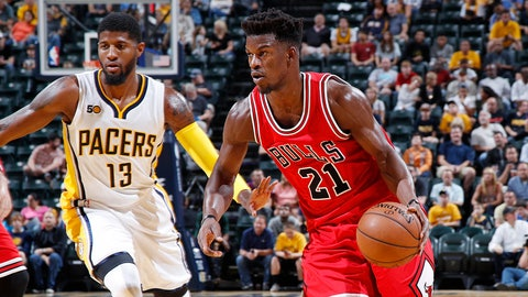INDIANAPOLIS, IN - OCTOBER 06: Jimmy Butler #21 of the Chicago Bulls drives against Paul George #13 of the Indiana Pacers during a preseason game at Bankers Life Fieldhouse on October 6, 2016 in Indianapolis, Indiana. The Pacers defeated the Bulls 115-108. (Photo by Joe Robbins/Getty Images)