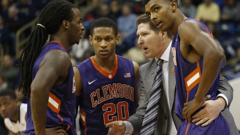 Jan 10, 2015; Pittsburgh, PA, USA; Clemson Tigers head coach Brad Brownell (RC) talks with guard Rod Hall (L) and guard Jordan Roper (20) and forward Donte Grantham (R) on the sidelines against the Pittsburgh Panthers during the second half at the Petersen Events Center. Clemson won 71-62. Mandatory Credit: Charles LeClaire-USA TODAY Sports