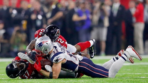HOUSTON, TX - FEBRUARY 05:  Julian Edelman #11 of the New England Patriots makes a 23 yard catch in the fourth quarter against Ricardo Allen #37 and Keanu Neal #22 of the Atlanta Falcons during Super Bowl 51 at NRG Stadium on February 5, 2017 in Houston, Texas.  (Photo by Kevin C. Cox/Getty Images)