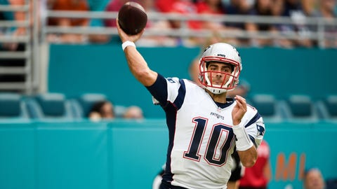 New England Patriots quarterback Jimmy Garoppolo (10) passes during the NFL week 17 football game against the Miami Dolphins on Sunday, Jan 1, 2017 in Miami Gardens, Fla.  The Patriots defeated the Dolphins 35-14.  (Jim Mahoney via AP)